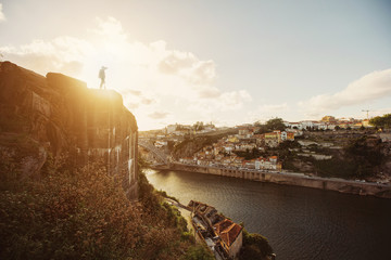 Traveler staying on high cliff in Porto City centre, Portugal travel