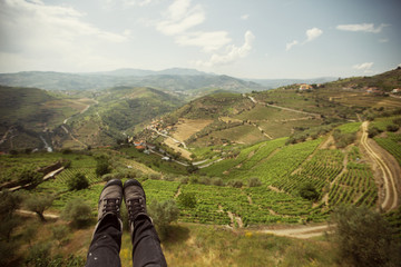 Traveler foot on grape fields mountains landscape in Portugal