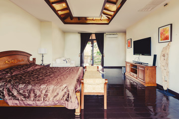 Luxury villa bedroom interior, wooden floor