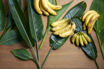 Four bunches of bananas on leaves