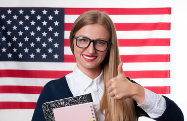 Student is learning English as a foreign language on American flag  background