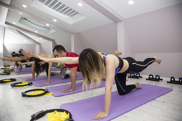 pilates foam exercise with group plank