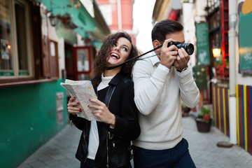 Young happy couple having fun with camera