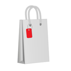 White paper package on a white background. Red label. Blank paper bag . Mock up. 3d