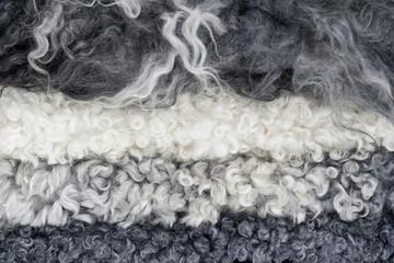 Close up of piled sheep skins