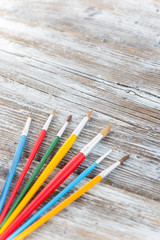 paint brushes on wooden background, special tools for creative people, back to school, education background,
