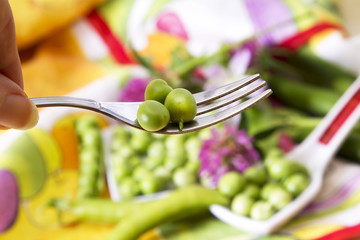 Fork with green peas
