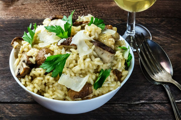 Photo of mushroom risotto with glass of white wine
