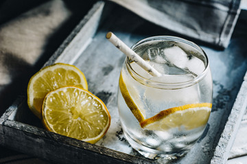 Sparkling water with lemon slices and ice cubes