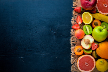 Set of fresh fruits. Healthy food. On Wooden background. Top view. Free space.