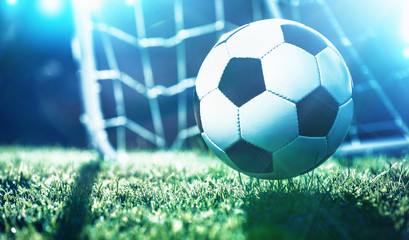 Soccer ball on the field of stadium