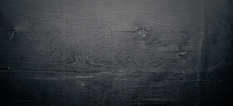 Wooden structural black background. Top view. Free space.