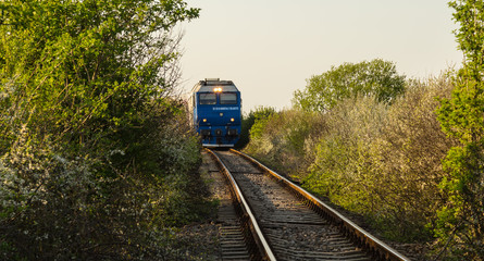 Old railroad and train in remote rural area in Europe