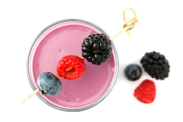 Healthy berry smoothie in glass isolated on white background