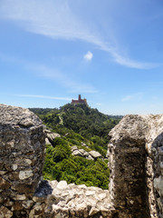 Walls of the Moorish Castle and Pena Palace in the background in Sintra, Portugal