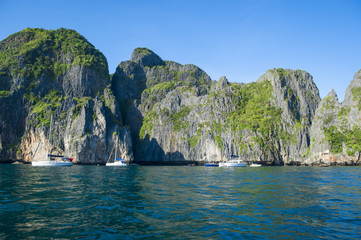 MAYA BAY, THAILAND - NOVEMBER 12, 2014: Visitors enjoy a morning moment of quiet before the crowds arrive at Maya Bay, one of the iconic beaches of Southern Thailand.