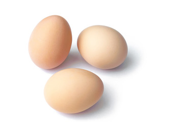 brown hen eggs on white background