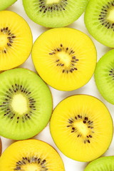 slices of fresh green and yellow kiwi fruits food background texture