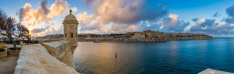 Senglea, Malta - Sunset and panoramic skyline view at the watch tower of Fort Saint Michael, Gardjola Gardens with beautiful sky and clouds Wall mural
