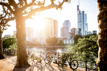 View on the financial district with Main river and park during the sunset in Frankfurt city, Germany