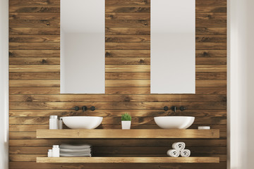 Two sinks with posters