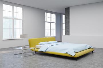 Yellow bed, concrete floor corner