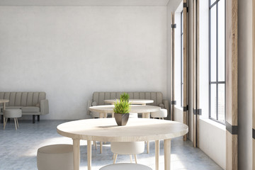 Cafe with round tables, sofas