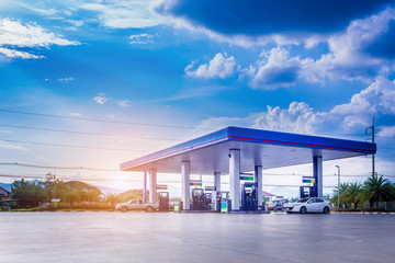 Gas station with clouds and blue sky