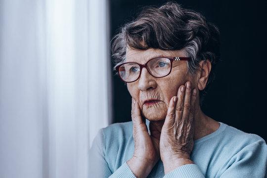 Sad woman in glasses
