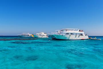 three yacht at sea