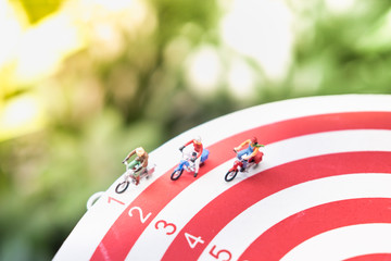 Miniature figure toys cyclist ride bike in racing lane with copy space, business competition for success background concept