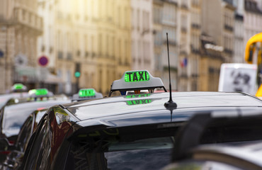 TAXI - green sign in Paris, France