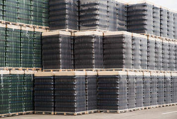 Several stacks of colorful beverage bottle crates outdoors