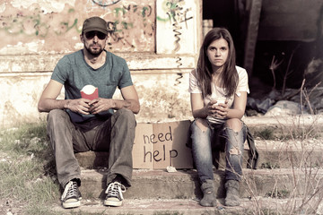 Poor people sitting on the street