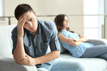 Sad young man after quarrel with girlfriend