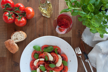 Appetizer caprese with a glass red wine