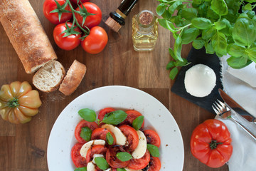 Mediterranean caprese salad served on a rustic wooden table