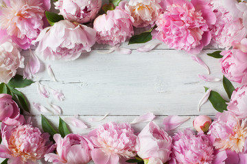 Pink peonies on a wooden background