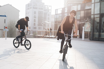two young man using bmx