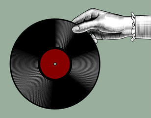 Woman's hand with a gramophone record