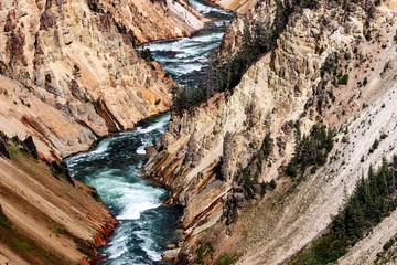 High Angle View Of River Amidst Rocky Mountains At Yellowstone National Park