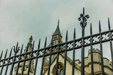 Detail of the Big Ben tower seen behind bars, England
