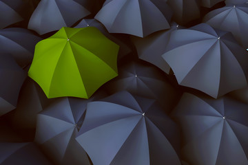 Grüner Regenschirm zwischen vielen grauen Regenschirm
