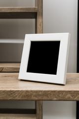 Black space on white wooden frame