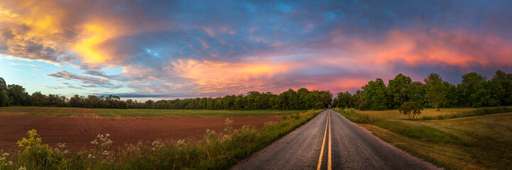 Beautiful sky with country road Wall mural