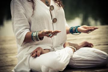 woman hands in yoga symbolic gesture mudra Wall mural