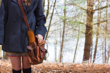 Teen Girl in Winter Pea Coat with Leather Bag 1