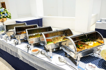 Close up  countertop food warmer and dish on table, catering concept