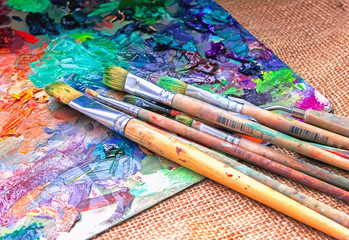 artist brush and palette with paints oil painting impressionism