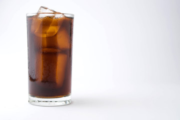 cola with ice in glass on white background with copy space